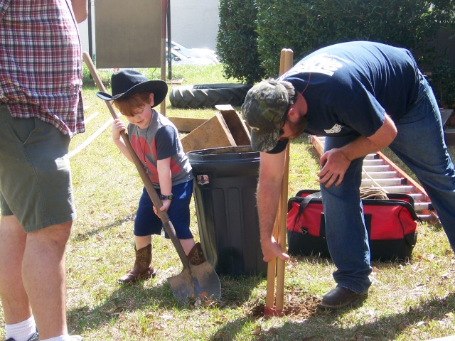 Eli and Matthew Cade dig holes for the crosses.